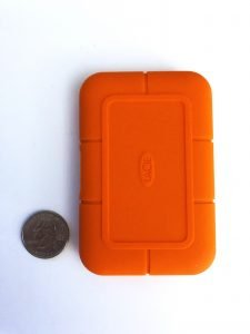 lacie rugged ssd next to quarter