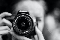 holding camera up to eye